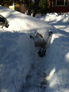 Two feet of snow covered our car